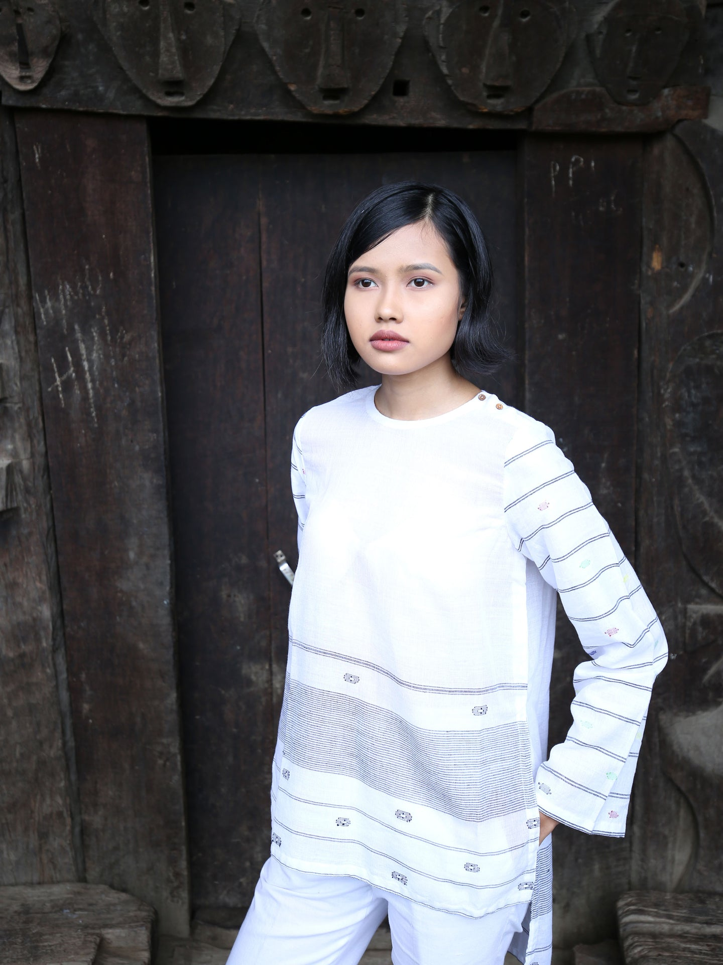 Handwoven cotton full sleeves top with extra weft designed by Khumanthem Atelier