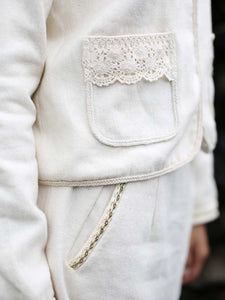 close up view of the lace details on the pockets of the Short coat, designed by Khumanthem Atelier