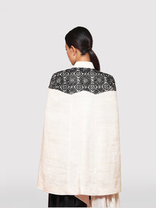 Creme cape with intricate black hand-embroidery