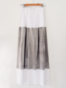 Back view of white cotton Pleated skirt with stripes, designed by Khumanthem Atelier