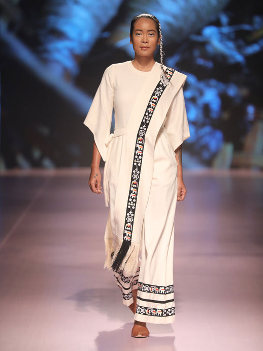 Front view of model ramp walking wearing Jumpsuits for women (Sha-Nga Motiff), designed by Khumanthem Atelier during the Lakme Fashion Week 2018