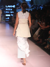 Load image into Gallery viewer, ramp walk back view of model wearing off white handwoven silk corset, designed by Khumanthem Atelier, during Lakme Fashion Week, 2018