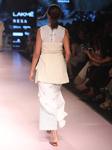 ramp walk back view of model wearing off white handwoven silk corset, designed by Khumanthem Atelier, during Lakme Fashion Week, 2018