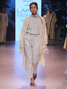Ramp walk view of model wearing white an blue checked Sleeveless top with gathered collar and waist, designed by Khumanthem Atelier, during Lakme Fashion Week, 2018