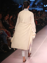 Load image into Gallery viewer, Ramp walk Back view of model wearing the off white handwoven silk coat, designed by Khumanthem Atelier, during Lakme Fashion Week, 2018
