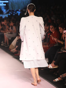 Ramp walk Back view of model wearing White petal sleeves coat for women handwoven from cotton designed by Khumanthem Atelier, during Lakme Fashion week, 2018