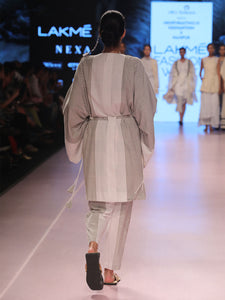 Ramp walk back view of model wearing Handwoven Kimono Sleeve Coat, made from cotton, designed by Khumanthem Atelier, during Lakme Fashion Week, 2018