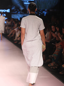 Ramp walk back view of model wearing Handwoven Straight Checkered Tunic Dress (Shamee-Lanmee Motif), designed Khumanthem Atelier, during Lakme Fashion week 2018