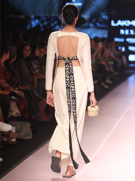 Creme blouse with tasseled tie-up at back, embroidered with traditional Shami-Lanmi motif