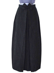 Front view of the pinstriped box skirt designed by Khumanthem Atelier