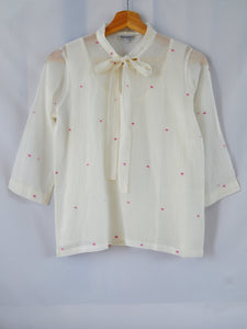 Front View of Hanger Shoot Handwoven Dainty Pink dots cotton blouse