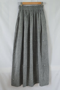 Hanger shoot back view Handwoven Elastane cotton skirt, designed by Khumanthem Atelier