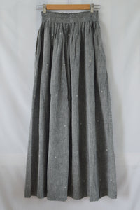 Hanger shoot front view Handwoven Elastane cotton skirt, designed by Khumanthem Atelier