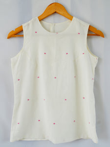Handwoven cotton sleeveless top with pink dots. Opening with hooks at the back