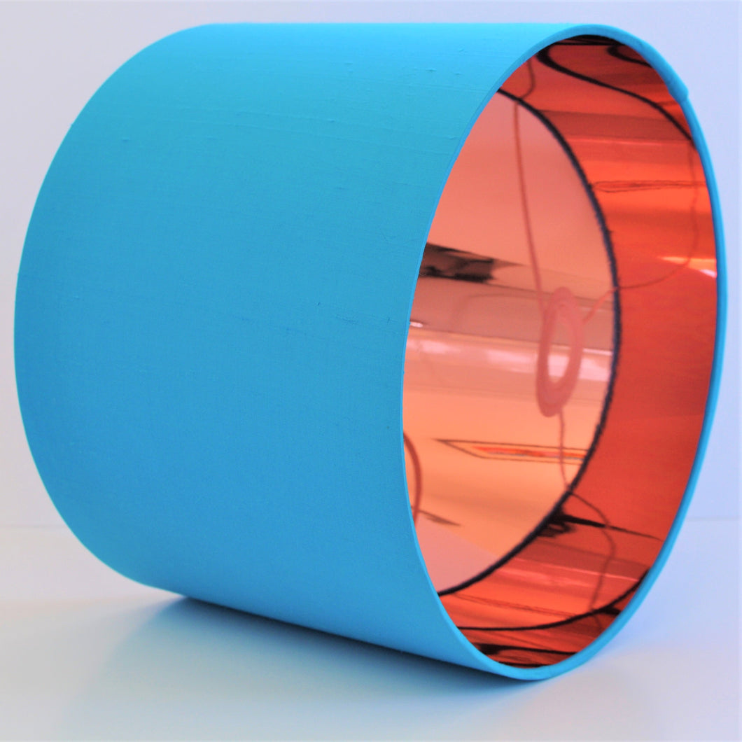 Bright blue silk lampshade with mirror copper liner