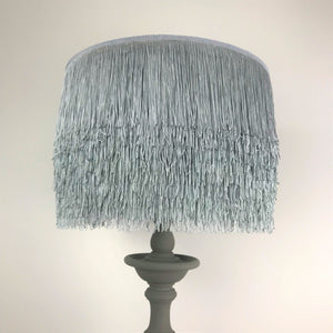 Grey tassel lampshade with Cole & Son liner