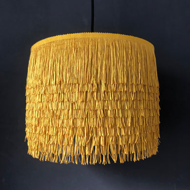 Gold tassel lampshade with Cole & Son liner