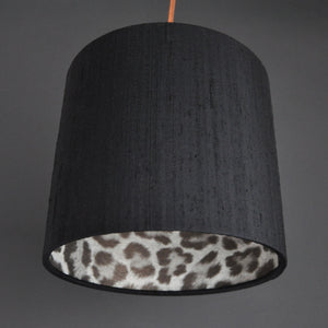 Leopard print wallpaper with black silk lampshade