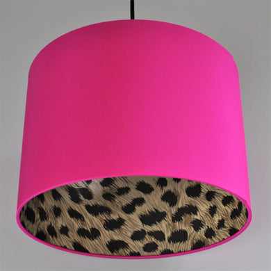 Leopard print wallpaper with hot pink silk lampshade