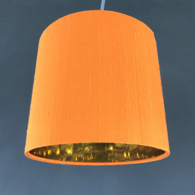 Tangerine silk lampshade with mirror gold liner