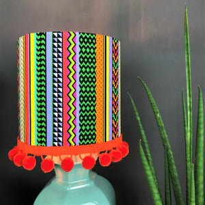 Multi-stripe fabric with mirror copper liner and optional orange pompom lampshade