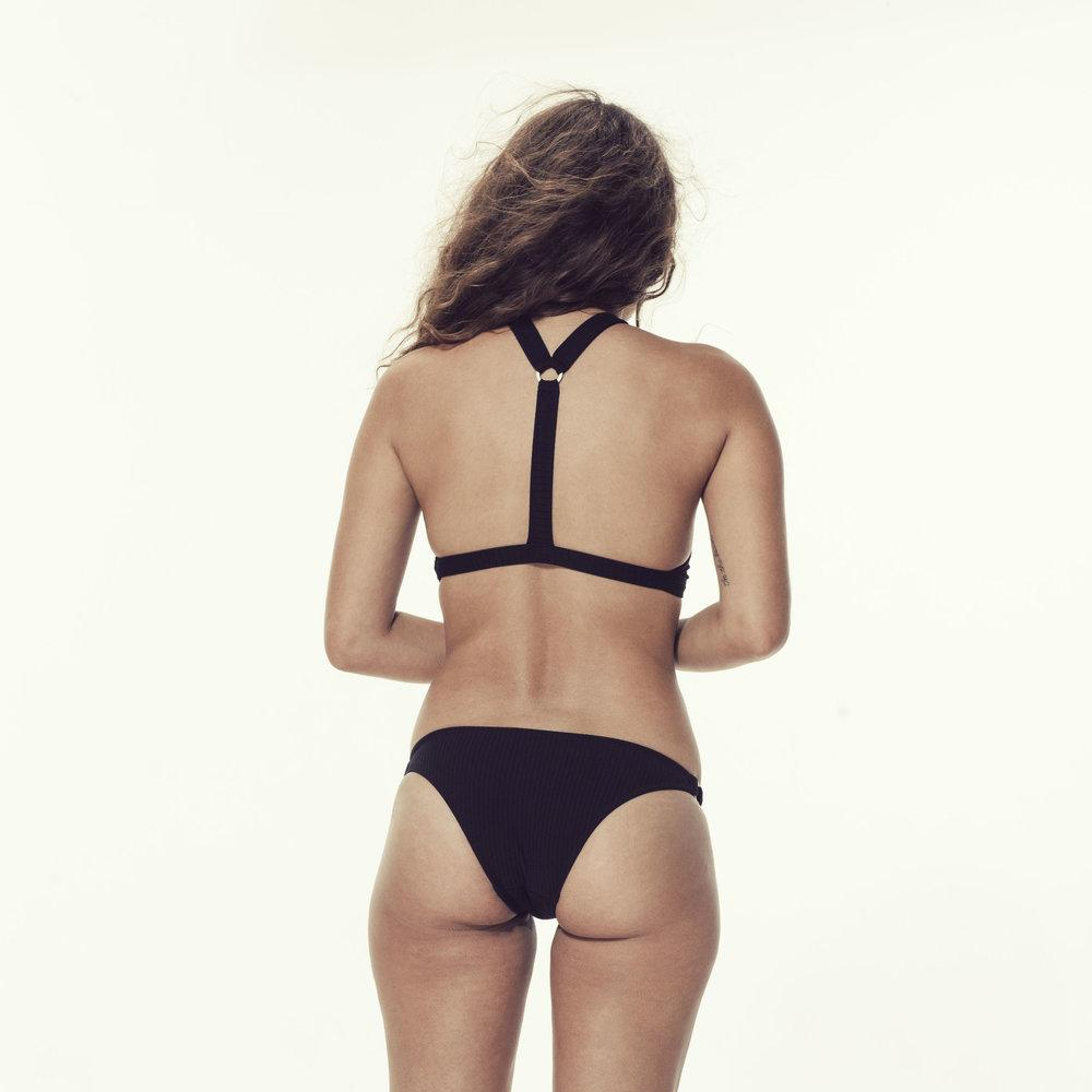 Woman wearing black two piece swimsuit