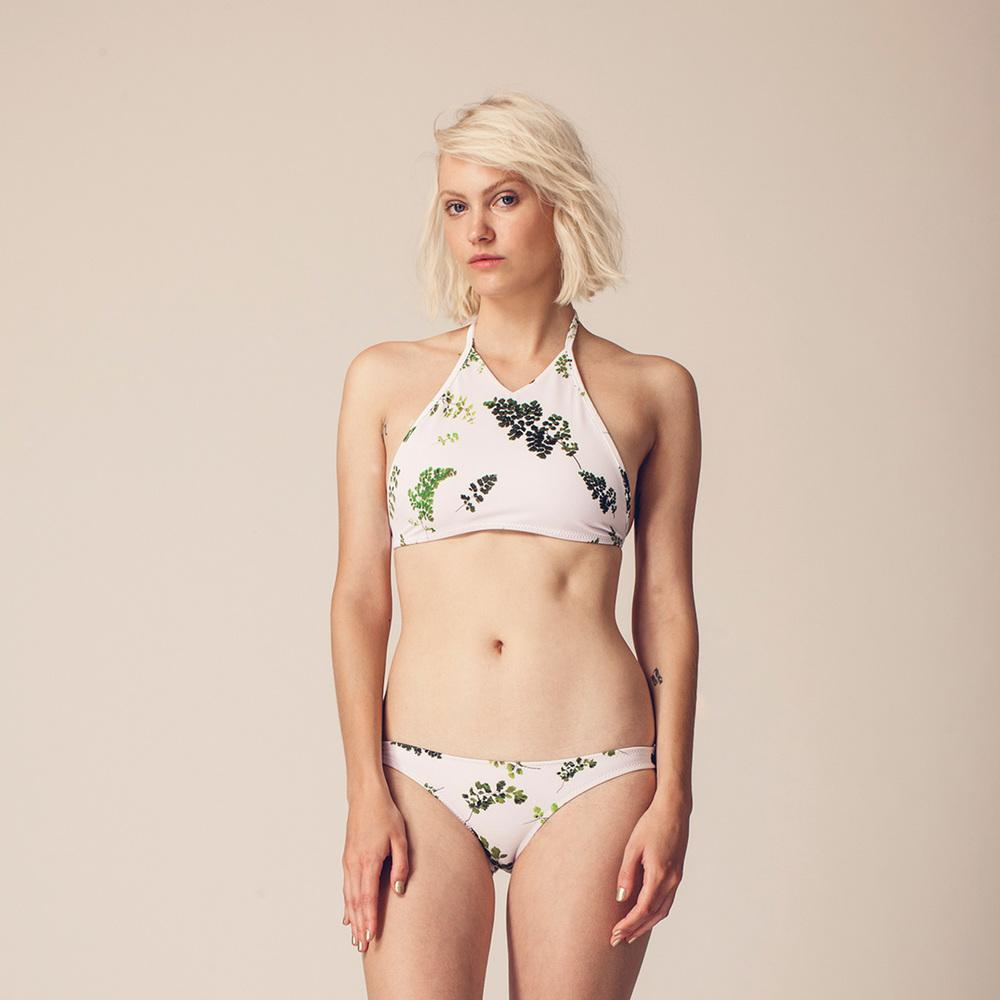 On model photo of two piece bikini with leaf print
