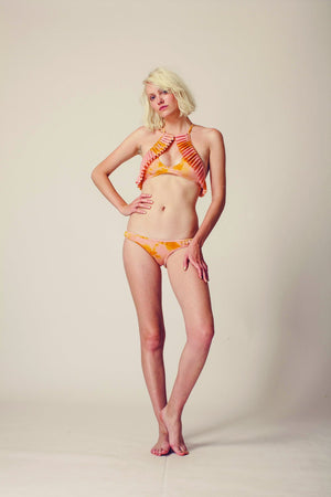 On model shot of orange tie-dyed bikini bottom and top
