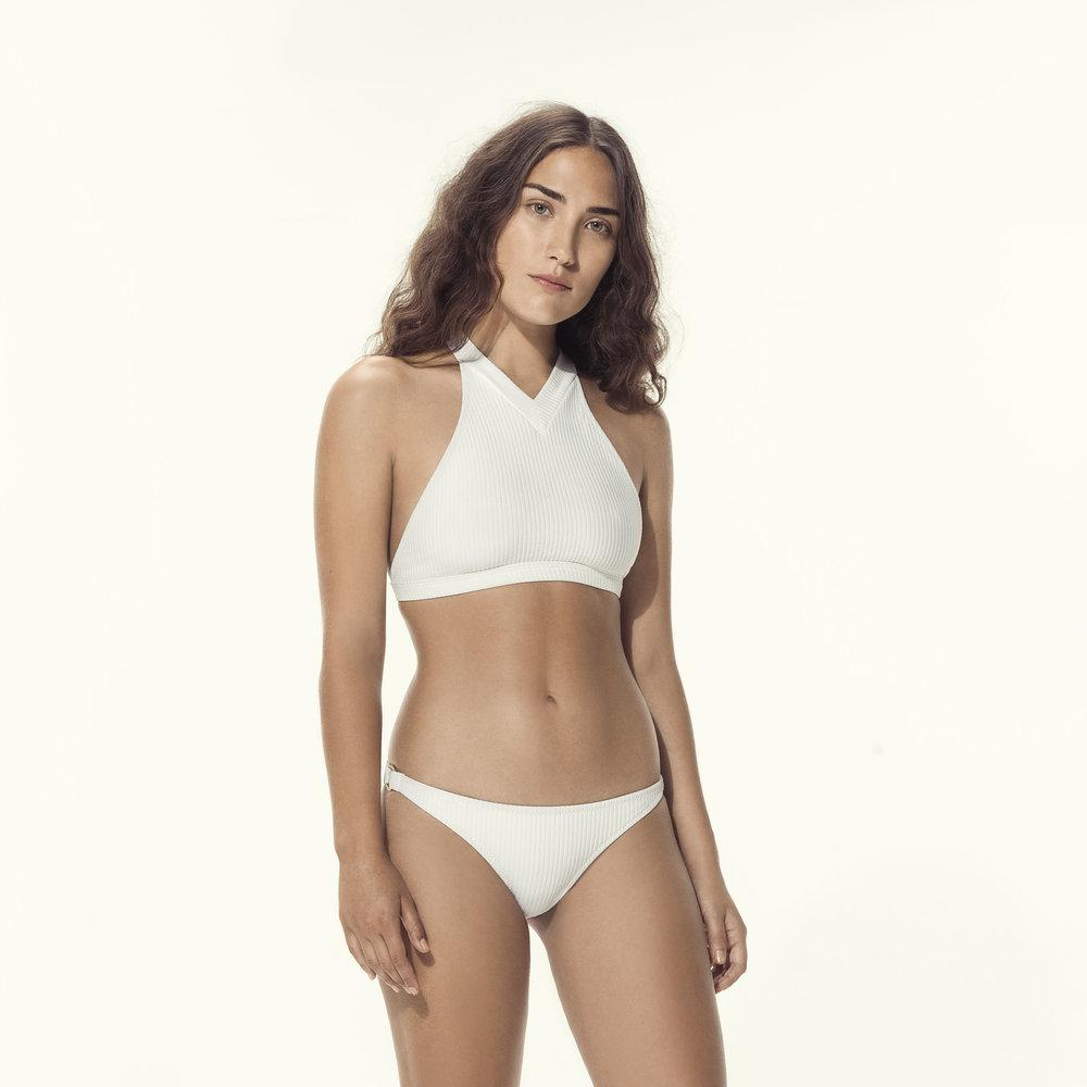 Woman wearing two piece cream swimsuit
