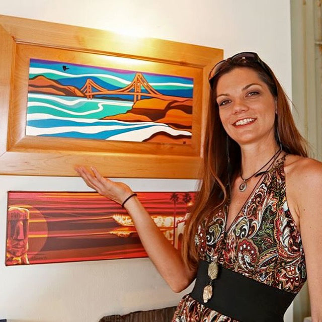Janessa Bookout poses with her painting