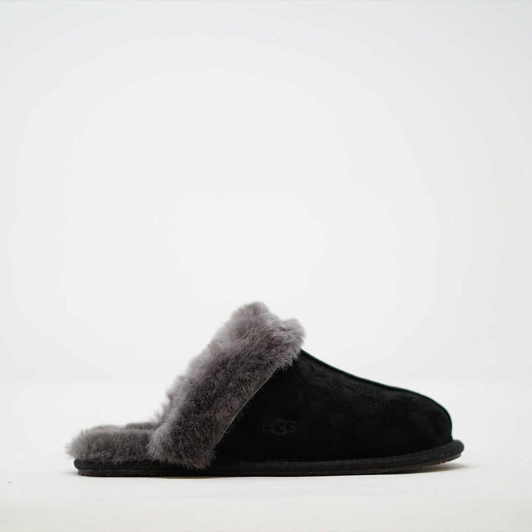 Scuffette II from UGG is a slipper made from black suede with a sheepskin lining.
