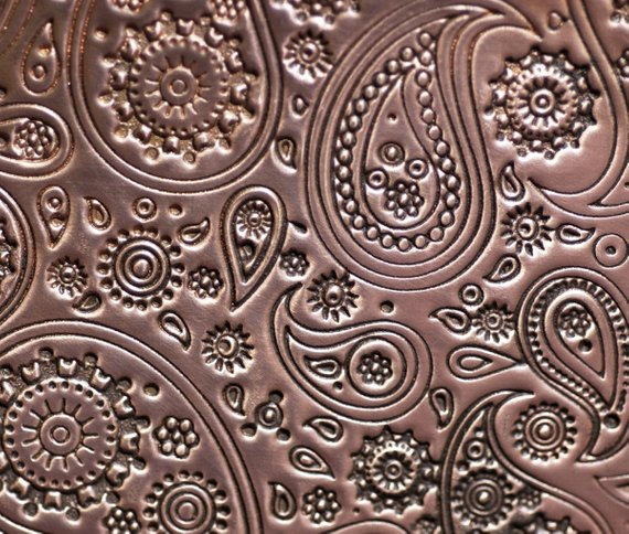 paisley pattern textured sheet metal in copper
