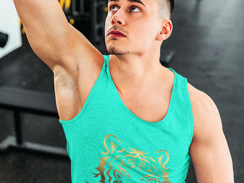 Image of a man in a gym wearing a teal JrKickz men's tank top.