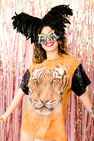 Girl in tiger sequin sleeve shirt