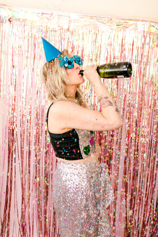 Girl in sequins drinking champagne