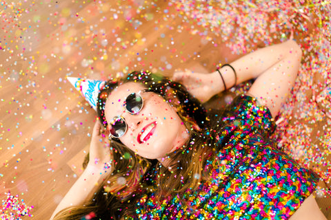 Girl laying in confetti