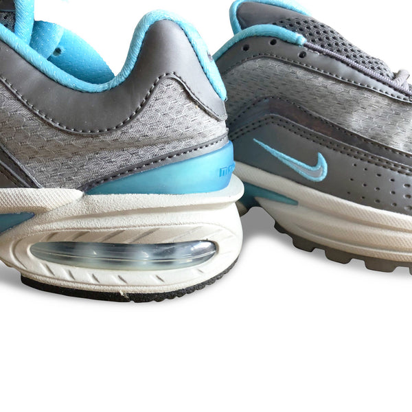 Close up of the Nike Air Max Allure 2004 with grey and mint color accents and big air bubble sole unit.