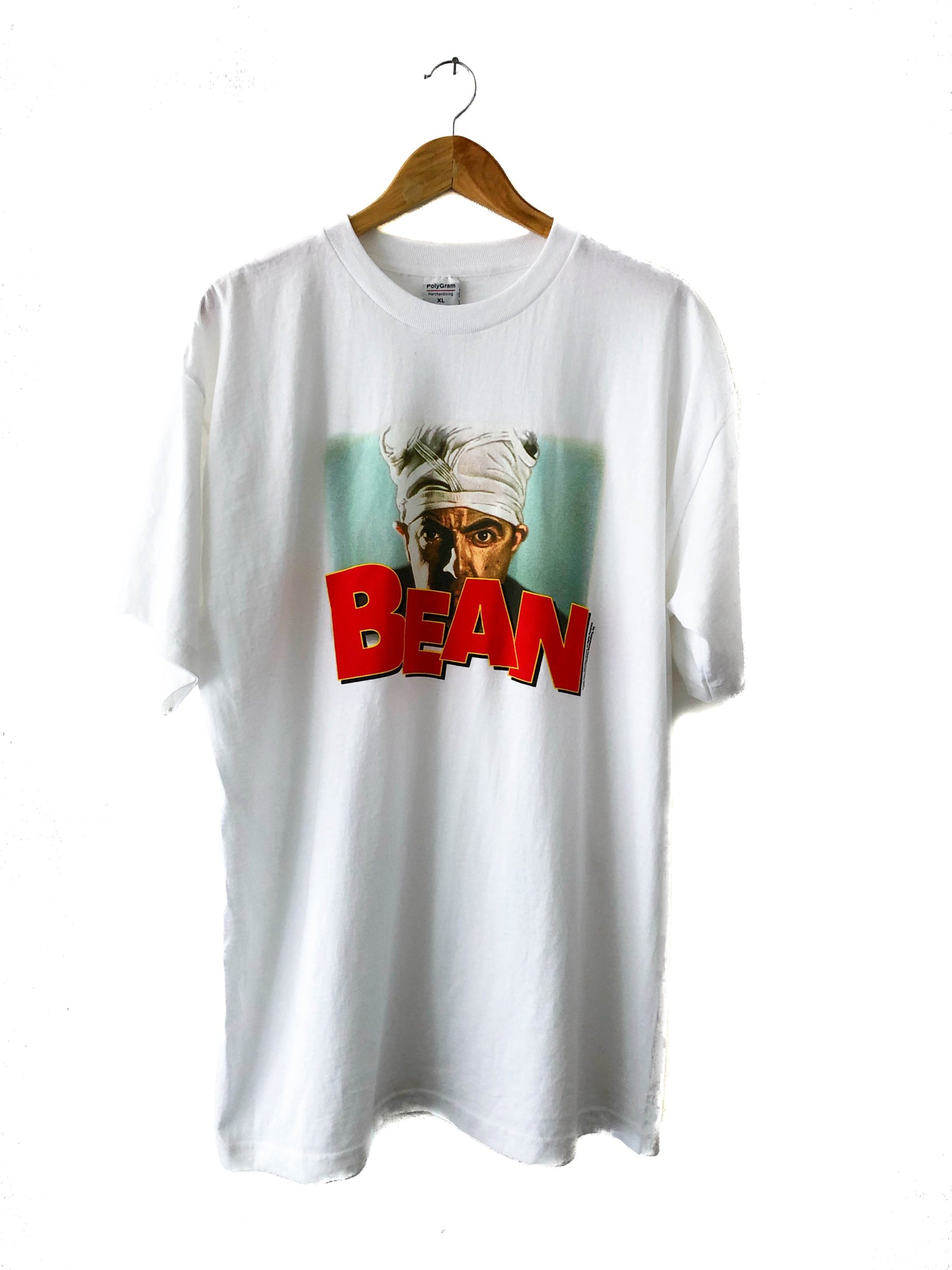 tshirt on hanger showing showing red lettering and mr bean wearing a turban