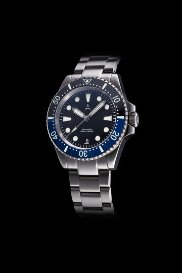 The Axios Ironclad Ocean Gulf features a blue-black ceramic bezel with a black sunburst dial and finished with double domed Sapphire crystal glass.