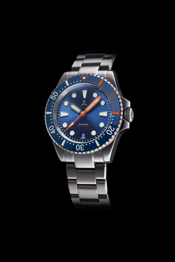 The Axios Ironclad Horizon features a blue sunburst dial and orange accents on its ceramic bezel that is finished with double domed Sapphire crystal glass.