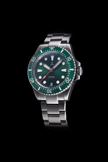 The Axios Ironclad Northern Sky features a green sunburst dial and deep green ceramic bezel that is finished with double domed Sapphire crystal glass.