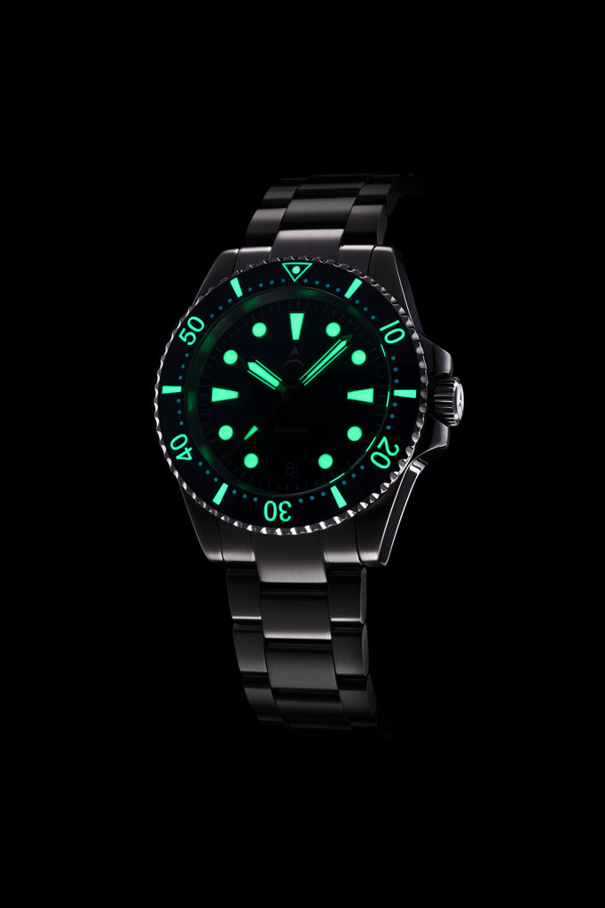 The Axios Ironclad Emerald Night features a deep green ceramic bezel contrasting with a black sunburst dial and finished with double domed Sapphire crystal glass.