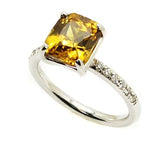 Yellow zircon ring .