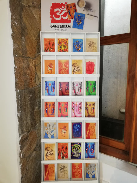 Rack of postcards in Ganeshim gallery