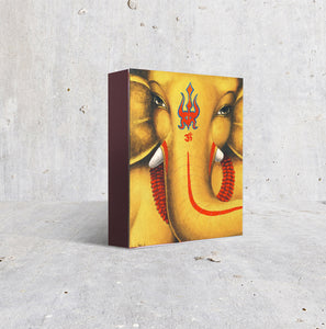 Lord Ganesh soothing face in gold and dark orange