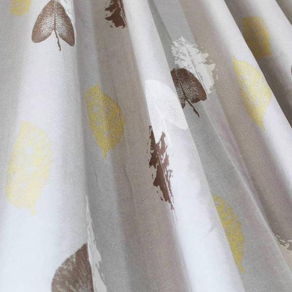 yellow leaf grey curtains