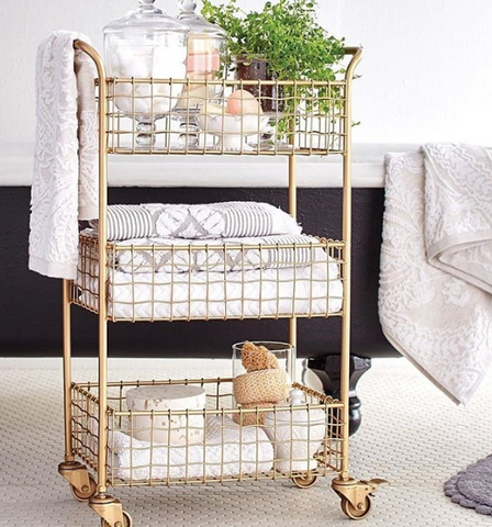 Gold cart with towels and bath products
