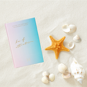 law of attraction journal and sea shells