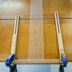 The Oxford Frame Loom attached to a table to extend the warp