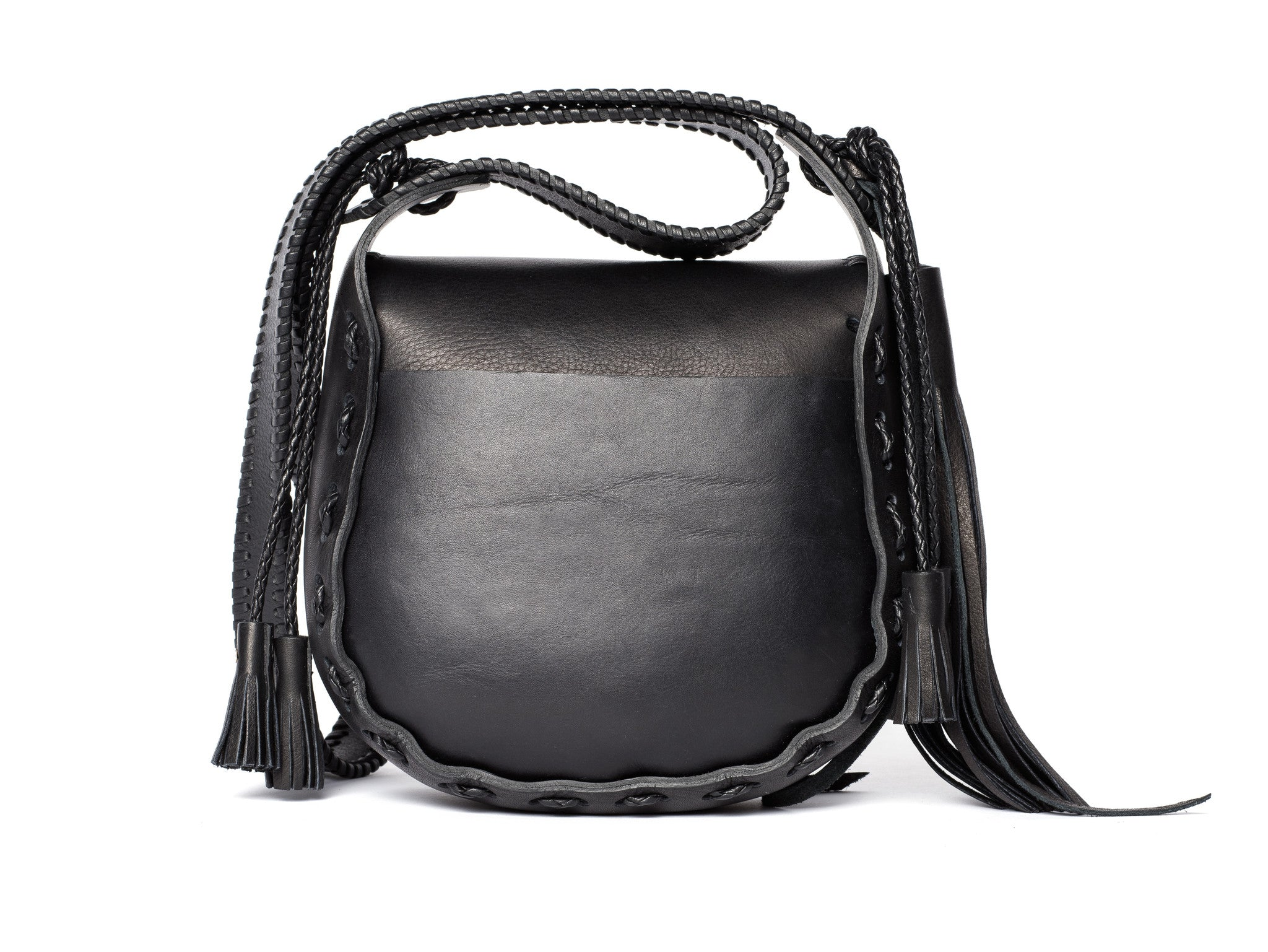 Small Whipstitch Satchel Black Leather Bag Wendy Nichol Handbag Purse Designer Handmade in NYC New York City Whipstitch Strap Durable Comfortable Cross Body Everyday Simple Elegant Medium Size Bag Fringe Tassel Envelope Flap Magnet Magnetic Closure Interior Pocket outside pocket Classic Saddle Satchel High Quality Leather